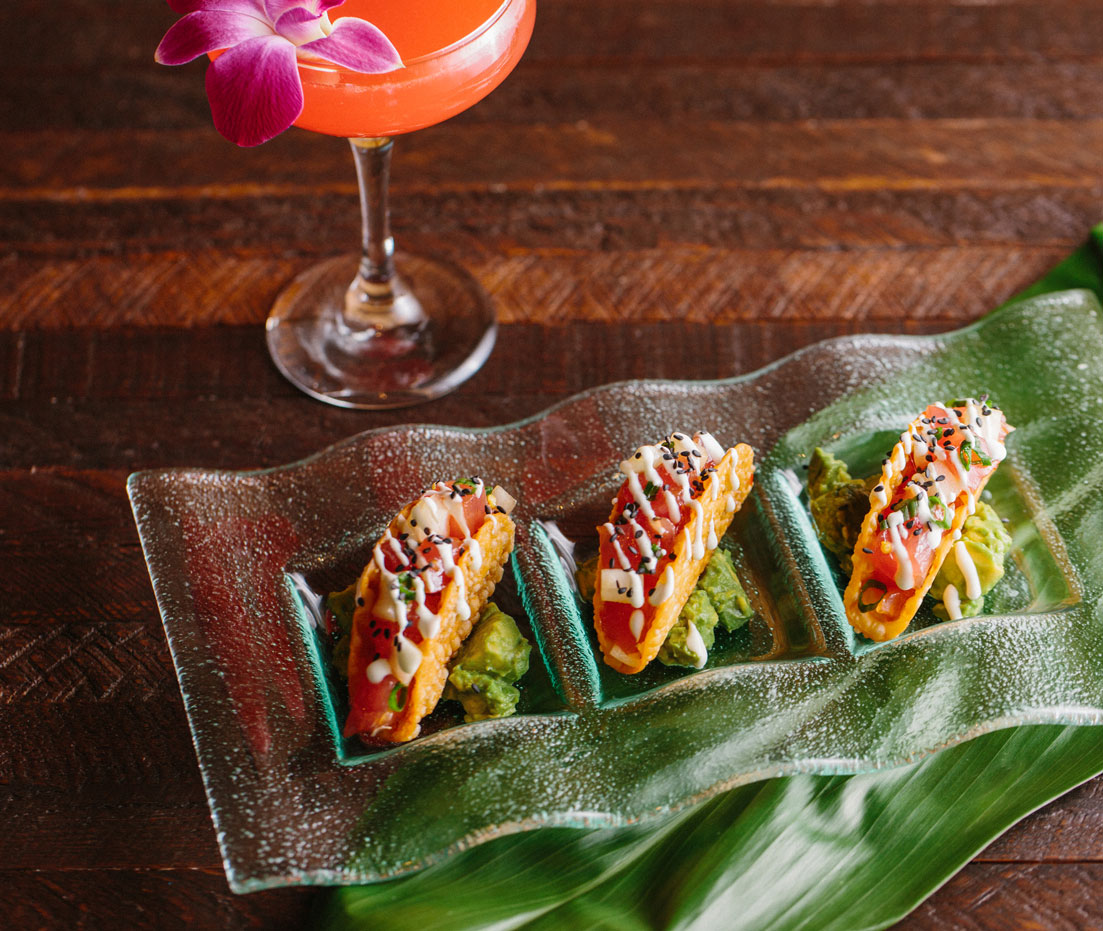 plate of ahi tacos and cocktail